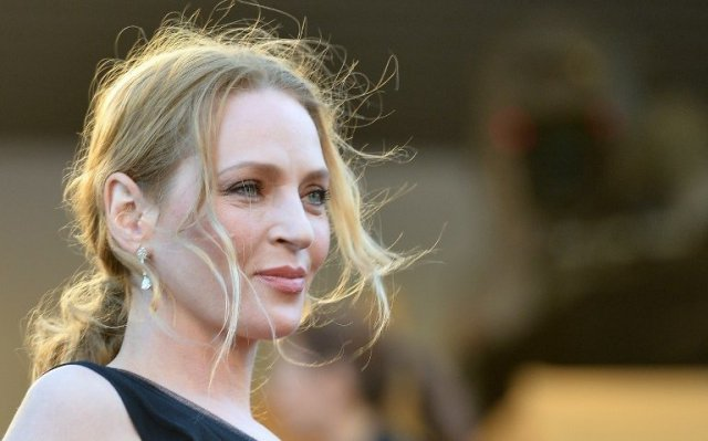 Uma Thurman remettra le prix Lumière 2013 à Quentin Tarantino - (archives mai 2013) / © AFP PHOTO / ALBERTO PIZZOLI