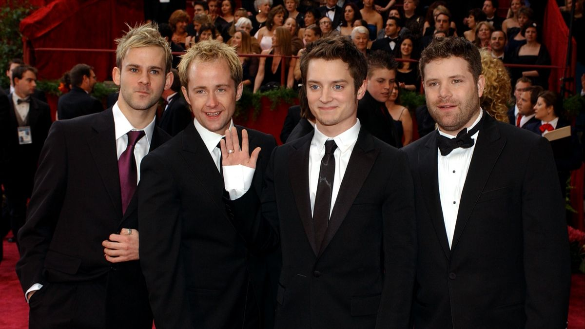 De gauche à droite, des acteurs du Seigneur des Anneaux Dominic Monaghan, Billy Boyd et Elijah Wood, Sean Astin. / © VINCE BUCCI / GETTY IMAGES NORTH AMERICA / AFP