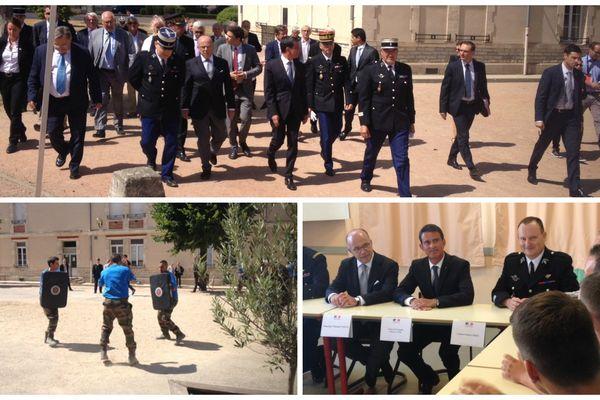 Manuels Valls et Bernard Cazeneuve en visite à l'école de gendarmerie de Montluçon, ce jeudi 11 août.