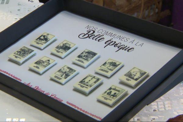 Les cartes postales anciennes sont reproduites sur les fèves.