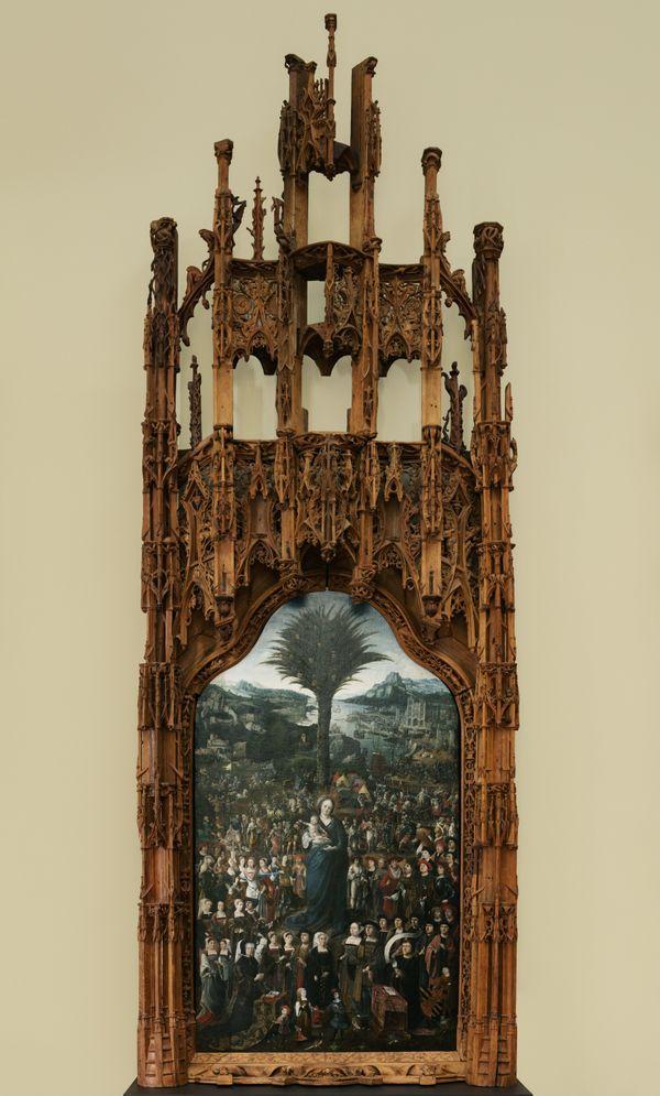 Certains Puys bénéficient de cadres en chêne sculpté comme celui de 1520. Maître d'Amiens ? Palme eslute du Sauveur pour victoire dite Vierge au palmier, huile sur panneau et cadre en chêne sculpté, 383 x 147 cm
