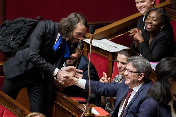 Cédric Villani (LREM) et Jean-Luc Mélenchon (LFI), en décembre 2017 à l'Assemblée nationale.