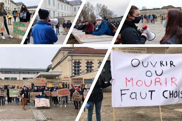 Marion Vailler ( masquée en noir avec le porte-voix à la main ), présidente du bureau des étudiants de l'UTT de Troyes, alerte sur la détresse des premières années mais aussi des autres niveaux.