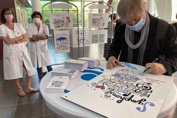 Plantu dédicace un dessin en l'honneur du personnel hospitalier du CHU de Reims