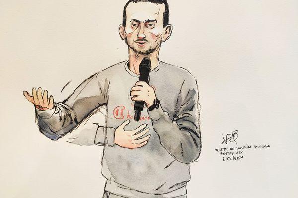 Montpellier - Mohamed Guendouz accusé du meurtre de Joaquim, devant les Assises de l'Hérault. Il mime le geste mortel qu'il a fait avec son couteau - 8 février 2021.