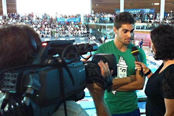 Interview de Thomas Rabeisen par France 3 Bourgogne à la piscine olympique de Dijon pendant la préparation aux championnats du monde de natation en juillet 2013