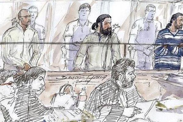 (De g à d) Mohamed Al Mesbah El Hafiani, Gregory Serge Boudrioua et Mehdi Hammami debouts dans le box des prévenus lors de leur procès à Paris, le 23 octobre 2014