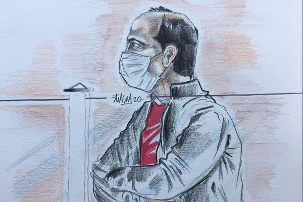 L'accusé au premier jour de son procès en appel