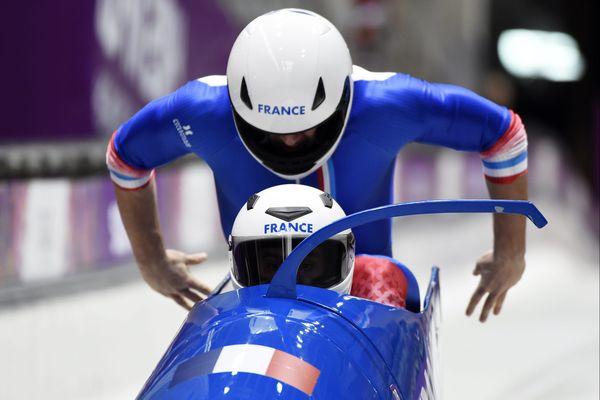 En 2014, pour ses 1ers Jeux, Romain Heinrich était pousseur (ici, debout, en action). En Corée, il prendra la place du pilote, à l'avant.
