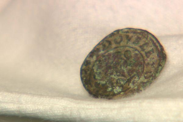 Une pièce de monnaie datant du règne d'Henri IV.