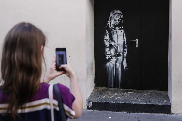 Banksy volé au Bataclan à Paris: 6 personnes inculpées et écrouées