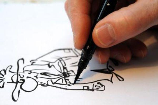 Le dessinateur Pétillon au travail, en 2013