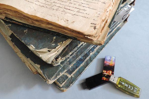 Les archives papiers deviennent peu à peu des archives numériques
