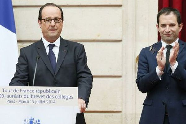 Benoît Hamon applaudit François Hollande après un discours du président de la République - 15 juillet 2014