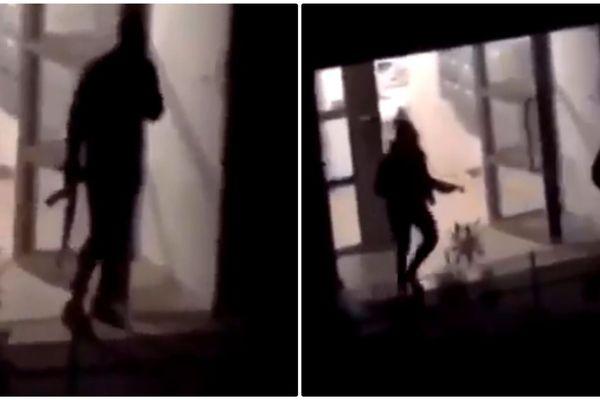 L'un des protagonistes de la fusillade filmé avec une arme longue, type Kalachnikov, à la main.