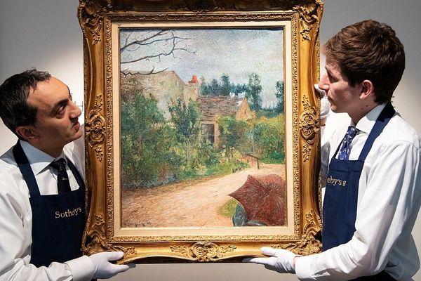 """Le tableau de Paul Gauguin """"Le Jardin de Pissarro, Quai du Pothuis"""" présenté à la presse par Sotheby's à Paris le 14 février"""