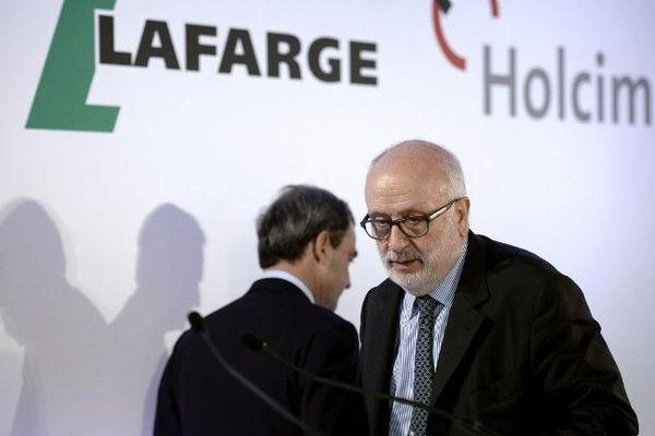 Les dirigeants des deux groupes lors d'une conférence de presse à Paris le 7 avril 2014.