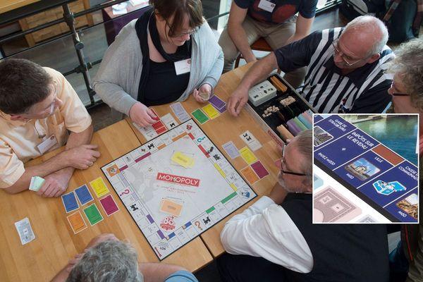 """Des joueurs de Monopoly. En médaillon, la case """"Lille"""" dans la nouvelle version du jeu."""