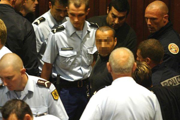 Karim Hadadcha, le visage flouté, lors d'un procès en 2003.