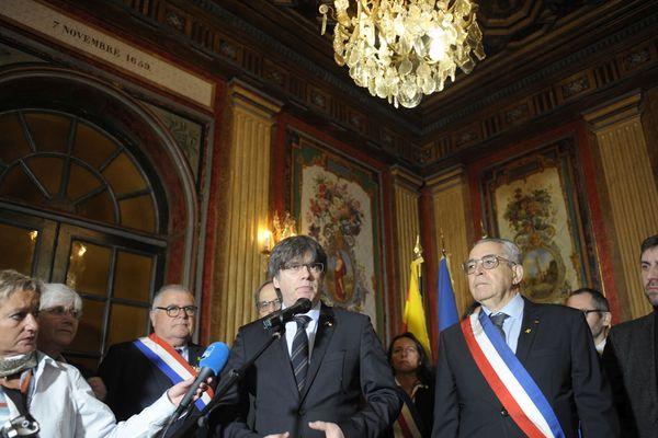 Carles Puigdemont aux cotés du maire à Perpignan, le 29.02.20: date du meeting géant du leader indépendantiste. 100.000 sympathisants étaient venus écouter l'ex-président de la Generalitat, deux ans après le début de son exil.