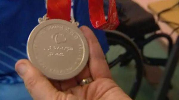 Médaille olympique.