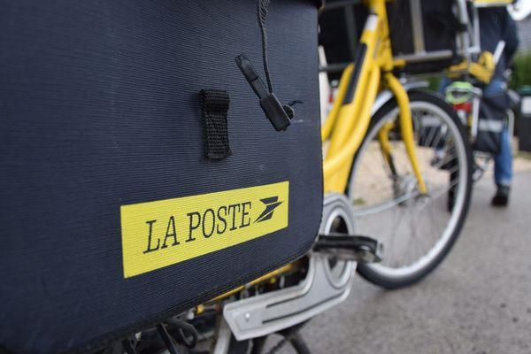 Deux facteurs à vélo - Photo d'illustration