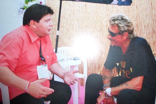 Erwan avec Johnny Hallyday pendant les Vieilles Charrues