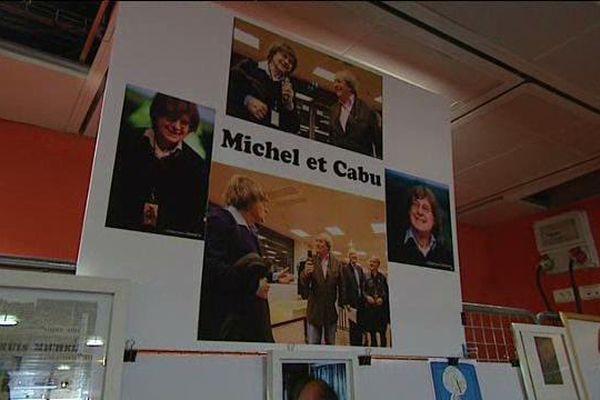 Dans les allées du Polydôme, hommage à Michel Renaud, fondateur des rendez-vous du carnet de voyage, et Cabu, dessinateur de Charlie Hebdo, assassinés le 7 janvier dernier à Paris.