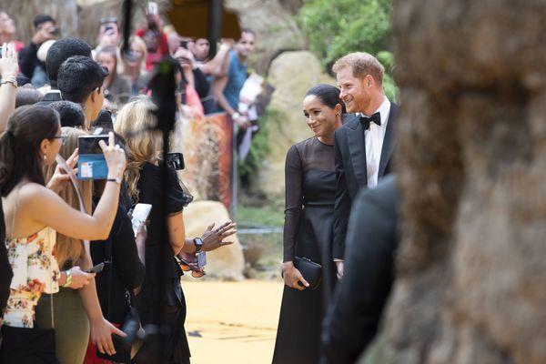 """Le couple princier lors de la sortie du film """"le Roi lion"""" à Londres en juillet dernier."""