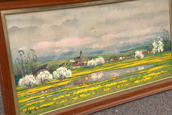 Cette réalisation du peintre Rex Barrat représente le village d'Oudan, une commune située à côte de Varzy.