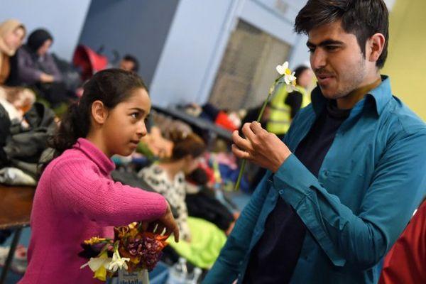 Des réfugiés attendant leur départ en CAO.
