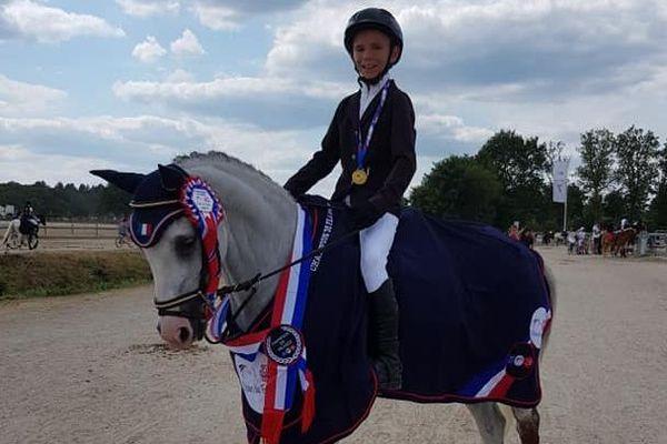 """Nohé Vincent et son poney """" un Bijou du Logis"""" sont champions de France 2019 du concours complet d'équitation dans la catégorie P3B"""
