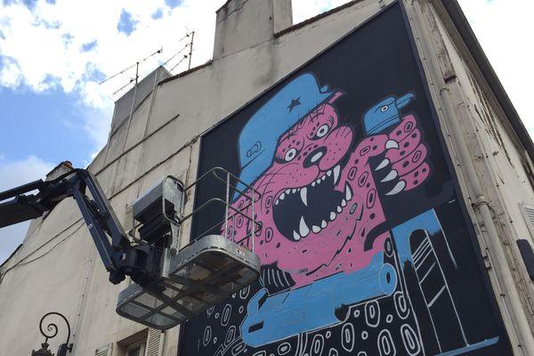Une fresque éphémère de l'artiste Poch réalisée sur un mur de de 7 mètres sur 4  à Dijon.