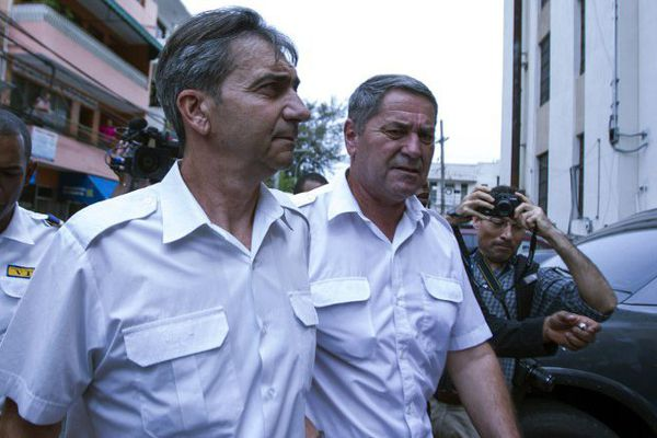 Bruno Odos et Pascal Fauret se rendent à leur audience, à Saint-Domingue, le 17 juin 2014.