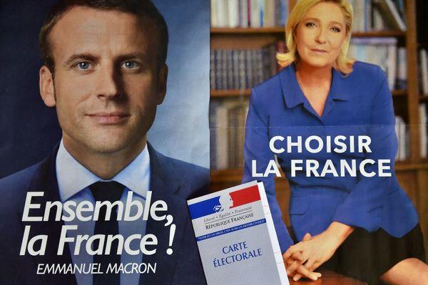 Les affiches des deux candidats au second tour de la présidentielle : Emmanuel Macron (EM) et Marine Le Pen (FN)