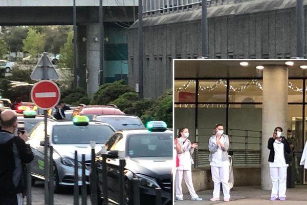 Les personnels soignants ont applaudi le geste des taxis venus leur rendre hommage à l'hôpital mère-enfant à Lyon 8ème.
