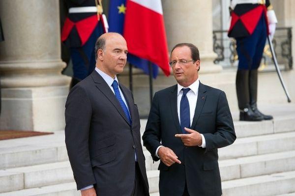 Sur le perron d'Elysée le 25 août 2012, Pierre Moscovici et François Hollande