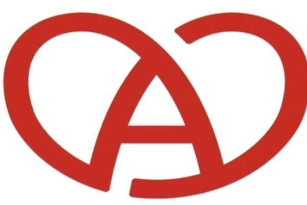 Un bretzel rouge sur fond blanc, un A au centre  et ..une bougie . La marque Alsace a un an