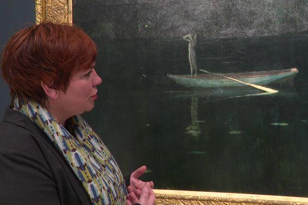 """La commissaire de l'exposition et directrice du Louvre-Lens Marie Lavandier nous a fait visiter l'exposition. Ici, elle commente """"La solitude"""" d'Alexander Harrison."""