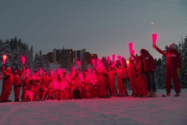 Descente aux flambeaux des moniteurs de l'ESF à Chamrousse en Isère