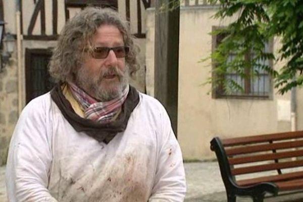 François Peyrout aimait peindre devant son échoppe, rue de la Boucherie.