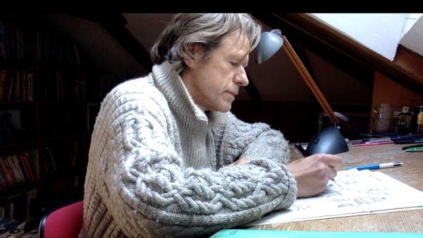 Didier Tronchet chez lui à sa table à dessin