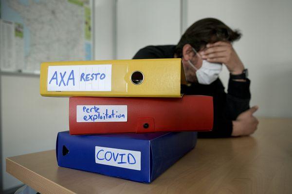 Illustration dans le cadre du combat judicaire entre un restaurateur et l'assureur Axa pour obtenir l'indemnisation de pertes d'exploitation en raison de l'épidémie de Covid-19. L'affaire avait été portée devant le tribunal de commerce de Lyon en novembre 2020.