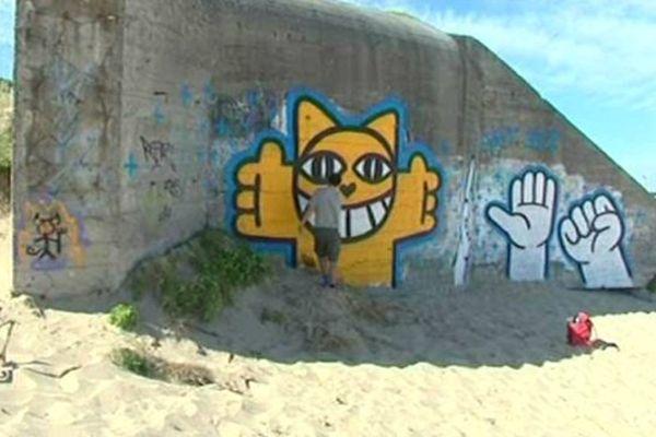 Thoma Vuille en train de graffer M.Chat.