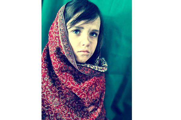 "Steve McCurry ""L'Afgane aux yeux verts"" imitation"