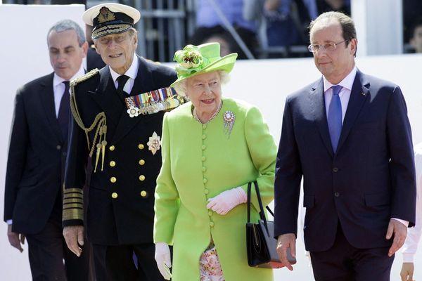 En 2014,  pour les 70 ans du Débarquement, la Reine accompagnée du Prince Philip accueillis par François Hollande
