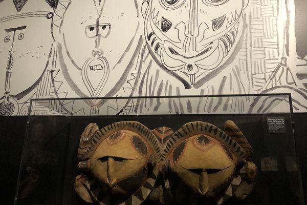 Masques prêtés par le musée du Quai Branly, dessin d'Hugo Pratt.