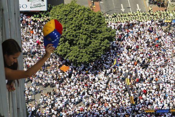 Avant de venir en France, Elyxandro vivait au Vénézuela. Il y a couvert plusieurs manifestations, comme cette marche de soutien à l'opposant Leopoldo Lopez, à Caracas, le 18 février 2014.