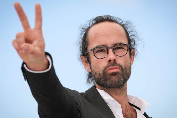 """Cédric Herrou, le 18 mai 2018, à Cannes, lors du photocall du documentaire """" Libre """"."""