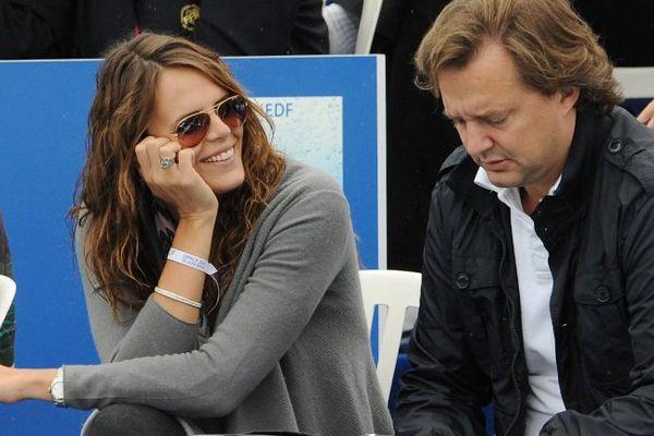 Didier Poulmaire aux côtés de Laure Manaudou en 2009.